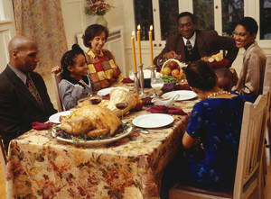 Photo - Family eating Thanksgiving dinner