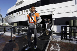 Photo - Denver Broncos wide receiver Andre Caldwell (12) leaves the luxury yacht where the team's daily news conferences are held Wednesday, Jan. 29, 2014, in Jersey City, N.J. The Broncos are scheduled to play the Seattle Seahawks in the NFL Super Bowl XLVIII football game Sunday, Feb. 2, in East Rutherford, N.J. (AP Photo/Mark Humphrey)