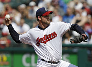 photo -   Cleveland Indians starting pitcher Derek Lowe delivers against the Los Angeles Angels in the first inning of a baseball game, Wednesday, July 4, 2012, in Cleveland. (AP Photo/Mark Duncan)