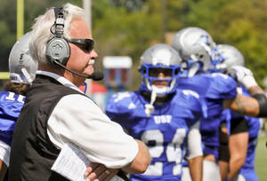 photo -   This Sept. 8, 2012, photo shows Kevin Donley, coach of the St. Francis Cougars, watches as his team plays St. Ambrose University during an NAIA college football game at Bishop D'Arcy Stadium in Fort Wayne, Ind. Donley and coach Hank Biesiot, of Dickinson State in North Dakota, will be chasing the same title on Saturday, Sept. 22, 2012. Both are tied with former Pacific Lutheran coach Frosty Westering with 256 career NAIA wins. (AP Photo/The Journal-Gazette, Michelle Davies) MANDATORY CREDIT; NO SALES; MAGS OUT; NEWS-SENTINEL OUT