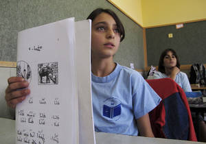 Photo -   In a Wednesday, May 2, 2012 photo, schoolgirls study Aramaic in the Arab village of Jish, northern Israel. Jish is one of two villages in the Holy Land's tiny Christian community that are teaching Aramaic to their children in an ambitious effort to preserve the language that Jesus spoke, centuries after it all but disappeared from the modern Middle East. (AP Photo/Diaa Hadid)
