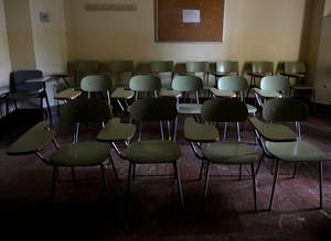 Photo - A picture taken on October 31, 2012 shows empty chairs in a classroom of the University of Seville, in Sevilla.  AFP PHOTO / CRISTINA QUICLER        (Photo credit should read CRISTINA QUICLER/AFP/Getty Images)