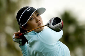 Photo - Michelle Wie watches her tee shot on the 11th hole during the second round at the Kraft Nabisco Championship golf tournament Friday, April 4, 2014, in Rancho Mirage, Calif. (AP Photo/Chris Carlson)