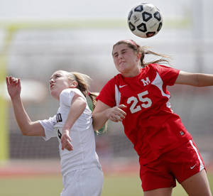 Photo - GIRLS HIGH SCHOOL SOCCER: Yukon's Ryle Danker (25) fights for the ball with Edmond's Katie Gilbert (8) during the Bronco Cup Soccer Tournament at Mustang High School on Thursday, March 28, 2013, in Mustang, Okla.  Photo by Chris Landsberger, The Oklahoman