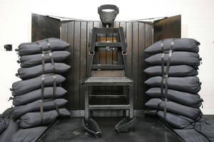 Photo - FILE - In this June 18, 2010, file photo, the firing squad execution chamber at the Utah State Prison in Draper, Utah, is shown. With lethal-injection drugs in short supply and new questions looming about their effectiveness, lawmakers in some death penalty states are considering bringing back relics of a more gruesome past, including firing squads. (AP Photo/Trent Nelson, Pool, File)