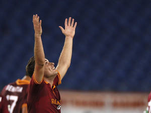 Photo - AS Roma forward Adem Ljajic of Serbia celebrates after scoring  during an Italian Serie A soccer match between AS Roma and Livorno at Rome's Olympic stadium, Saturday, Jan. 18, 2014. (AP Photo/Alessandra Tarantino)