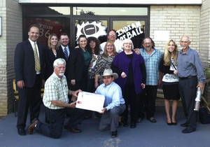 Photo - Attorneys pose with families affected by a 2006 sewage spill in Mill Creek, OK, after a jury in Johnston County awarded the plaintiffs $73 million in damages on Tuesday, Sept. 24, 2013. The two defendant companies did not appear for the trial. <strong></strong>