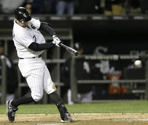 Photo - Chicago White Sox's Jeff Keppinger hits a game-winning single against the Miami Marlins during the 11th inning of a baseball game on Friday, May 24, 2013, in Chicago. The White Sox won 4-3. (AP Photo/Nam Y. Huh)