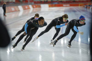 Photo - U.S. speedskaters Joey Mantia, rear left, Shani davis, front left, Brian Hansen, second right, and Jonathan Kuck, right, practice for the team pursuit at Adler Arena Skating Center during the 2014 Winter Olympics, Monday, Feb. 17, 2014, in Sochi, Russia. (AP Photo/Pavel Golovkin)