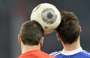 Photo - Mainz's Zdenek Pospech of Czech Republic, left, and Schalke's Leon Goretzka challenge for the ball during the German Bundesliga soccer match between FC Schalke 04 and FSV Mainz 05 in Gelsenkirchen,  Germany, Friday, Feb. 21, 2014. (AP Photo/Martin Meissner)