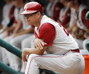 photo - OU head coach Sunny Golloway watches from the dugout during a Big 12 Baseball Championship tournament game between the Oklahoma Sooners and Baylor Bears at the Chickasaw Bricktown Ballpark in Oklahoma City, Saturday, May 26, 2012. OU won, 7-2. Photo by Nate Billings, The Oklahoman