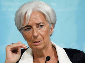 Photo - FILE - This July 3, 2012 file photo shows International Monetary Fund Managing (IMF) Director Christine Lagarde speaking in Washington. Lagarde travels the world trying to keep the global economy on track. But some of the greatest threats are brewing just blocks from her Washington office. And there's little she can do about them. The IMF has been left largely on the sidelines as Democratic and Republicans fights over the budget raise the specter of a U.S. default or possibly drive the country into recession. (AP Photo/Haraz N. Ghanbari, File)