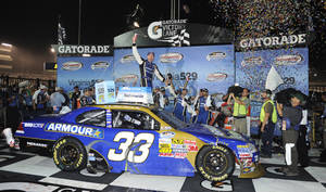 Photo -   Kevin Harvick celebrates after he won the NASCAR Nationwide Series auto race at Richmond International Raceway in Richmond, Va., Friday, Sept. 7, 2012. (AP Photo/Clem Britt)