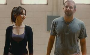 "Photo - Jennifer Lawrence and Bradley Cooper star in ""Silver Linings Playbook.""  The Weinstein Company photo"