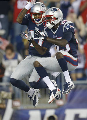 Photo - New England Patriots wide receiver Aaron Dobson (17) celebrates his touchdown against the New York Jets with wide receiver Kenbrell Thompkins, right, in the first quarter an NFL football game Thursday, Sept. 12, 2013, in Foxborough, Mass. (AP Photo/Elise Amendola)
