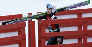 Photo - Japan's Sara Takanashi carries her skis during a women's ski jumping training session at the 2014 Winter Olympics, Saturday, Feb. 8, 2014, in Krasnaya Polyana, Russia. (AP Photo/Matthias Schrader)