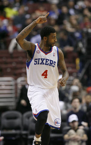 Photo - Philadelphia 76ers' Dorell Wright (4) celebrates after he scored against Golden State Warriors in the first half of an NBA basketball game on Saturday, March 2, 2013, in Philadelphia. (AP Photo/H. Rumph Jr)