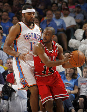 Photo - Chicago's John Lucas (15) looks to pass around Oklahoma City's Lazar Hayward (11) during the NBA basketball game between the Chicago Bulls and the Oklahoma City Thunder at Chesapeake Energy Arena in Oklahoma City, Sunday, April 1, 2012. Photo by Sarah Phipps, The Oklahoman