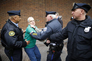 Photo - Police detain a protester demonstrating in opposition to the proposed Keystone XL oil pipeline, Monday, March 10, 2014, outside the Federal Building in Philadelphia. The protestors say the pipeline would contribute to global warming. (AP Photo/Matt Rourke)