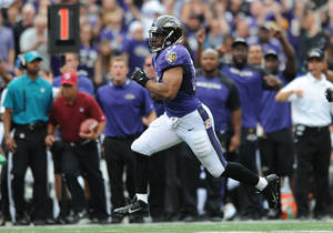 Photo - Baltimore Ravens inside linebacker Daryl Smith runs an interception back for a touchdown in the first half of an NFL football game against the Houston Texans, Sunday, Sept. 22, 2013, in Baltimore. (AP Photo/Gail Burton)