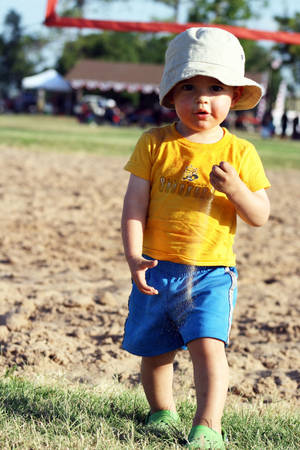 Photo - Noah Jackson, 2, plays in the sand at Reaves Park on July 4.