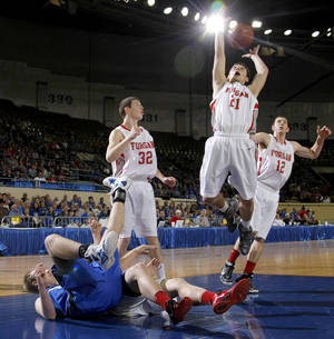 Photo - Forgan's Chandler Bryer, center, goes for a rebound beside teammate Jace Kerr, left, and Ryan Radcliff against Lomega in the semifinal game of the Class B boys state basketball tournament at State Fair Arena in Oklahoma CIty, Friday, March 3, 2012. Photo by Bryan Terry, The Oklahoman