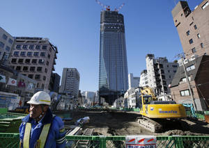 photo - A security man stands by a road construction site in Tokyo Friday, Jan. 11, 2013. Japan's newly installed prime minister Shinzo Abe has delivered a 20 trillion yen ($224 billion) stimulus package of public works and other projects aimed at revitalizing the sagging economy and providing support for struggling manufacturers, though it could. Abe said the measures announced Friday are intended to spur a 2 percent rise in real economic growth and create some 600,000 jobs. (AP Photo/Koji Sasahara)