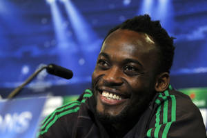 "Photo - FILE-In this Monday, March. 10, 2014, file photo, AC Milan's Michael Essien laughs during a press conference ahead of Tuesday's Champions League, soccer match against Atletico Madrid at the Vicente Calderon stadium, in Madrid.Ghana midfielder Michael Essien says the 2010 World Cup quarterfinalists are ""realistic enough"" to know that they have a much tougher challenge this time. Ghana made the quarterfinals and barely missed out on the semifinals in South Africa after a penalty shootout loss to Uruguay.  (AP Photo/Andres Kudacki,File)"