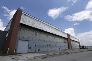 """Photo - FILE - In this July 17, 2013, file photo, part of the former Willow Run Bomber Plant stands in Ypsilanti Township, Mich. The Detroit-area factory where Rosie the Riveter showed that a woman could do a """"man's work"""" by building World War II-era bombers has been saved from the wrecking ball, organizers of a campaign to build a museum on the site announced Thursday, May 1, 2014. (AP Photo/Paul Sancya, File)"""
