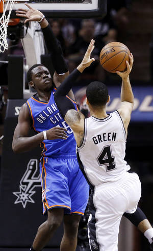 Photo - Oklahoma City's Reggie Jackson (15) defends San Antonio's Danny Green (4) during Game 5 of the Western Conference Finals in the NBA playoffs between the Oklahoma City Thunder and the San Antonio Spurs at the AT&T Center in San Antonio, Thursday, May 29, 2014. Photo by Sarah Phipps, The Oklahoman