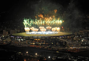 Photo - A fireworks display is seen over the Maracana stadium after the soccer World Cup final match between Argentina and Germany, in Rio de Janeiro, Brazil, Sunday, July 13, 2014. Mario Goetze volleyed in the winning goal in extra time to give Germany its fourth World Cup title with a 1-0 victory over Argentina. (AP Photo/Adriana Lorete-Agencia o Globo)