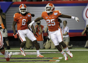 Photo -   Clemson running back Roderick McDowell (25) reacts after scoring a touchdown against Auburn in the second quarter of a NCAA college football game at the Georgia Dome in Atlanta Saturday, Sept. 1, 2012. At left is Clemson wide receiver DeAndre Hopkins (6). (AP Photo/Dave Martin)