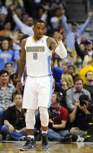 Photo - Denver Nuggets guard J.R. Smith celebrates a basket in the second half of an NBA basketball game against the Golden State Warriors in Denver on Monday, April 11, 2011.  The Nuggets won 134-111. (AP Photo/Chris Schneider) ORG XMIT: COCS110