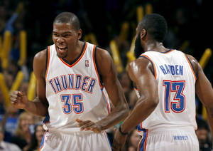 Photo - Oklahoma City's Kevin Durant (35) and James Harden (13) celebrate during the NBA game between the Oklahoma City Thunder and the Phoenix Suns, Sunday, March 6, 2011, the Oklahoma City Arena. Photo by Sarah Phipps, The Oklahoman