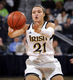 Photo - Notre Dame guard Kayla McBride throws a pass in the second half of an NCAA college basketball game with Boston College, Thursday, Jan. 9, 2014 in South Bend, Ind. Notre Dame won 95-53 with McBride leading all scorers with 20 points. (AP Photo/Joe Raymond)