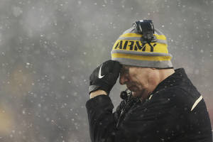 Photo - Army head coach Rich Ellerson puts his hand on his head after Navy scored a touchdown during an NCAA college football game, Saturday, Dec. 14, 2013, in Philadelphia. Navy won 34-7. (AP Photo/Matt Rourke)