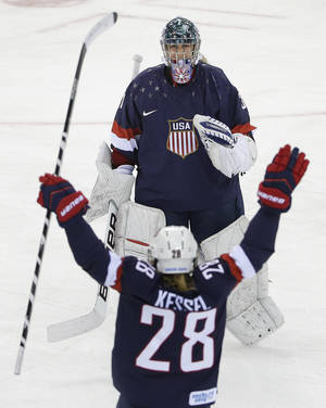 Photo -  USA Goalkeeper Jessie Vetter is greeted by Amanda Kessel after the USA beat Sweden 6-1 during the 2014 Winter Olympics women's semifinal ice hockey game at Shayba Arena, Monday, Feb. 17, 2014, in Sochi, Russia. (AP Photo/Matt Slocum)  <strong>Matt Slocum -   </strong>