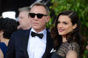 """Photo - FILE - In this Jan. 13, 2013 file photo, Daniel Craig, left, and Rachel Weisz arrive at the 70th Annual Golden Globe Awards at the Beverly Hilton Hotel in Beverly Hills, Calif.   Craig and Weisz are to play an adulterous stage couple in a Broadway production of Harold Pinter's """"Betrayal.""""  Broadway veteran Mike Nichols will direct the production, which previews from Oct. 1 and opens Nov. 3 at New York's Barrymore Theatre. The announcement was made Friday, April 5, 2013. (Photo by Jordan Strauss/Invision/AP)"""