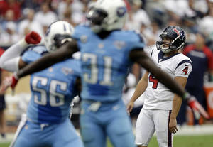 Photo - Tennessee Titans' Akeem Ayers (56) and Bernard Pollard (31) celebrate after Houston Texans' Randy Bullock (4) missed a field goal-attempt during the second quarter of an NFL football game on Sunday, Sept. 15, 2013, in Houston. (AP Photo/David J. Phillip)
