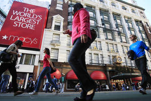 Photo - FILE -  In this Nov. 8, 2011, file photo, pedestrians pass the Macy's department store, in New York. Macy's Inc. is reporting quarterly earnings on Wednesday, Aug. 14, 2013. (AP Photo/Frank Franklin II, File)