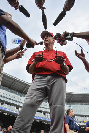 Photo - FILE- In this June 14, 2013, file photo, Indiana coach Tracy Smith talks to reporters during NCAA college baseball practice at TD Ameritrade Park in Omaha, Neb. Indiana's rise in baseball has been no surprise to the Big Ten. After the Hoosiers' historic 2013 season, the rest of the nation is now aware of the powerful program Tracy Smith has built.(AP Photo/Eric Francis)