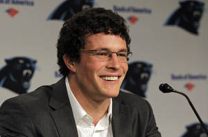 Photo -   Luke Kuechly, the Carolina Panthers first-round NFL football draft pick, smiles as he speaks to the media during a news conference in Charlotte, N.C., Friday, April 27, 2012. (AP Photo/Chuck Burton)