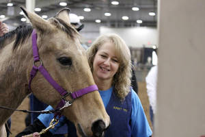 Photo - Glenda Bitner, volunteer with Sunset Therapeutic Riding Center in Yukon. <strong>Photo Provided - Photo Provided</strong>