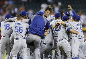 Photo - The Los Angeles Dodgers celebrate clinching the NL West title with a 7-6 win over the Arizona Diamondbacks in a baseball game Thursday, Sept. 19, 2013, in Phoenix. (AP Photo/Matt York)