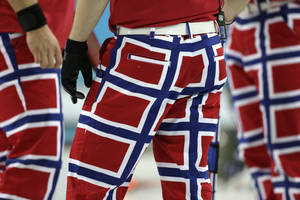 Photo - The Norway curling team's latest pants design, inspired by the country's flag, are seen during competition at the 2014 Winter Olympics, Thursday, Feb. 13, 2014, in Sochi, Russia. (AP Photo/Robert F. Bukaty)