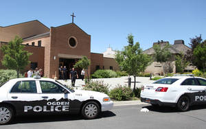 Photo - Police are outside St. James Catholic Church in Ogden, Utah, Sunday June 16, 2013 after a man was shot in the back of the head during mass at the church. The suspect, Charles Richard Jennings Jr., 35, was captured Sunday afternoon in nearby Box Elder County after fleeing in a stolen pickup truck, investigators said.  (AP Photo/Standard-Examiner, Benjamin Zack) TV OUT; MANDATORY CREDIT  MBO  (BENJAMIN ZACK/Standard-Examiner) MANDATORY CREDIT, LOCAL TV OUT