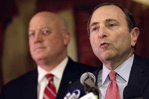 photo - NHL commissioner Gary Bettman, right, and deputy commissioner Bill Daly and speak to reporters on Thursday, Dec. 6, 2012, in New York. The NHL has rejected the players' latest offer for a labor deal and negotiations have broken off at least until the weekend. (AP Photo/Mary Altaffer)