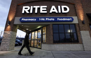 Photo - FILE - In this Dec. 15, 2009 file photo, a customer enters a Rite Aid store in Detroit. Rite Aid reports quarterly financial results on Thursday, June 19, 2014. (AP Photo/Paul Sancya, File)