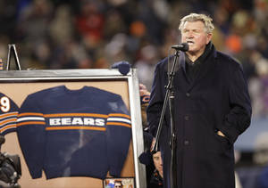 Photo - Former Chicago Bears player and coach Mike Ditka speaks to the fans at Soldier Field as his No. 89 is retired during a halftime ceremony of an NFL football game between the Bears and Dallas Cowboys, Monday, Dec. 9, 2013, in Chicago. (AP Photo/Nam Y. Huh)