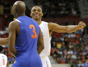 Photo - Russell Westbrook talks with Damien Wilkins before the US Fleet Tracking Basketball Invitational at the Cox Convention Center in Oklahoma City Sunday, Oct. 23, 2011. The White Team defeated the Blue Team 176-171. Photo by John Clanton, The Oklahoman